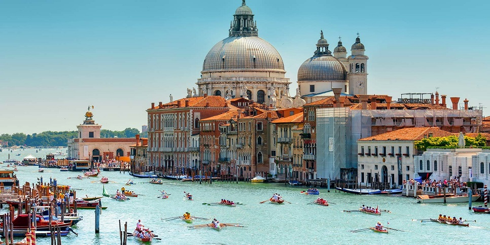 The Grand Canal in Venice, on the day of the Regatta of the Maritime Republics. Photo taken from the Academy bridge, looking towards the finish line in front of Santa Maria Della salute Church.
